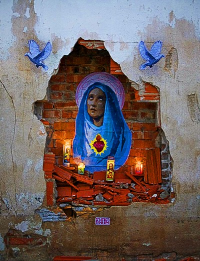 An urban decay altar in Galveston, Texas. The Virgin Mary, by artist 2:12 (photo courtesy Stencil History X)