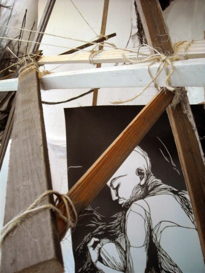 Found wood pieces strung together with twine frame this cut paper piece by Imminent Disaster (image courtesy ThinkSpace)