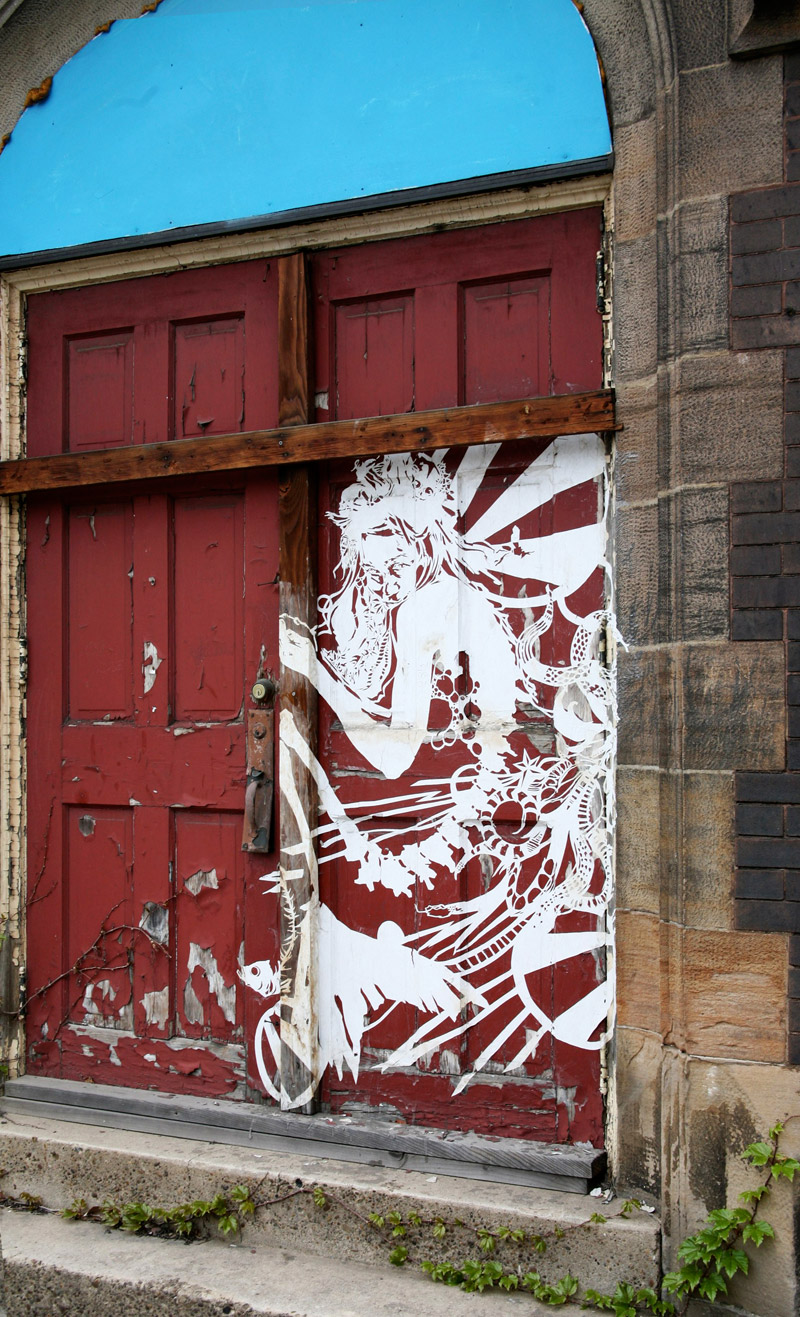 A piece by Swoon on an entrance to the church (photo © Salome Oggenfuss)