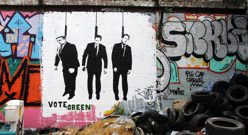In this scurrilous depiction of what appears to be UK politians hanging by the neck, T-Wat urges viewers to Vote Green. Please note that BSA would never advocate violence toward anyone. Period.