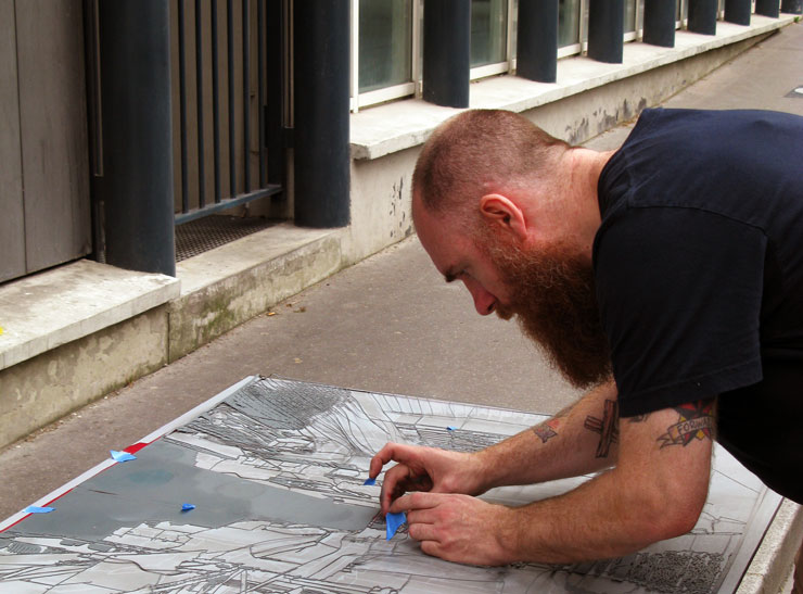 Logan Hicks in Paris Spraying Stencils on the Street for Show