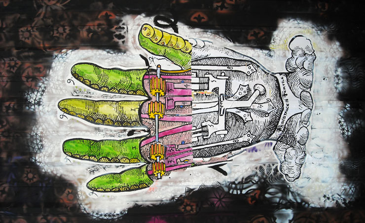 A mechanized hand combines industrial revolutionary diagrammatic style with a surreal quality of modern possibility. From a mural done with NOLA Rising (Buxtonia)