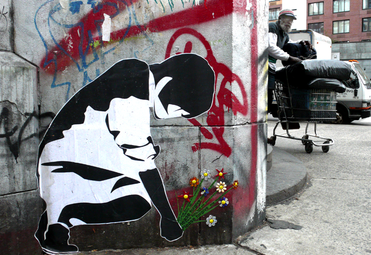 Street artist Wing placed her bouquet of glass tiles on an existing wheat paste by an unknown artist (Photo © Jaime Rojo)