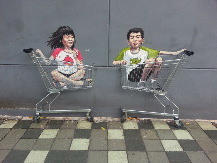 Ernest Zacharevic Plays on Walls in Singapore