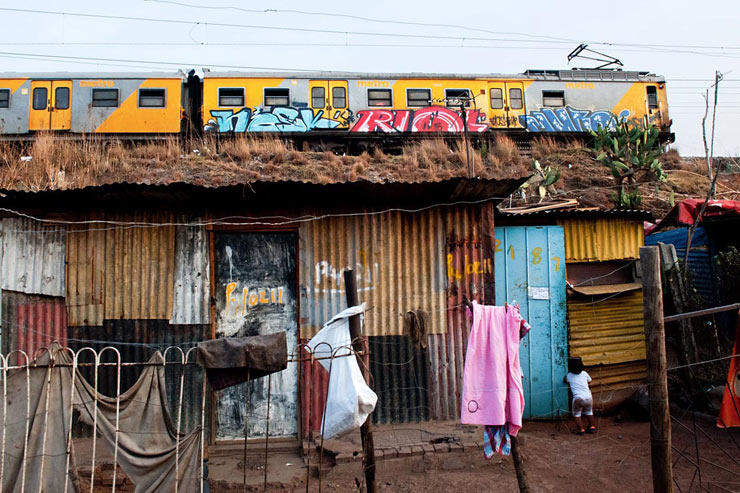 "13 from 2013 : Martha Cooper ""A Train Runs Through Mandela's Kliptown"""