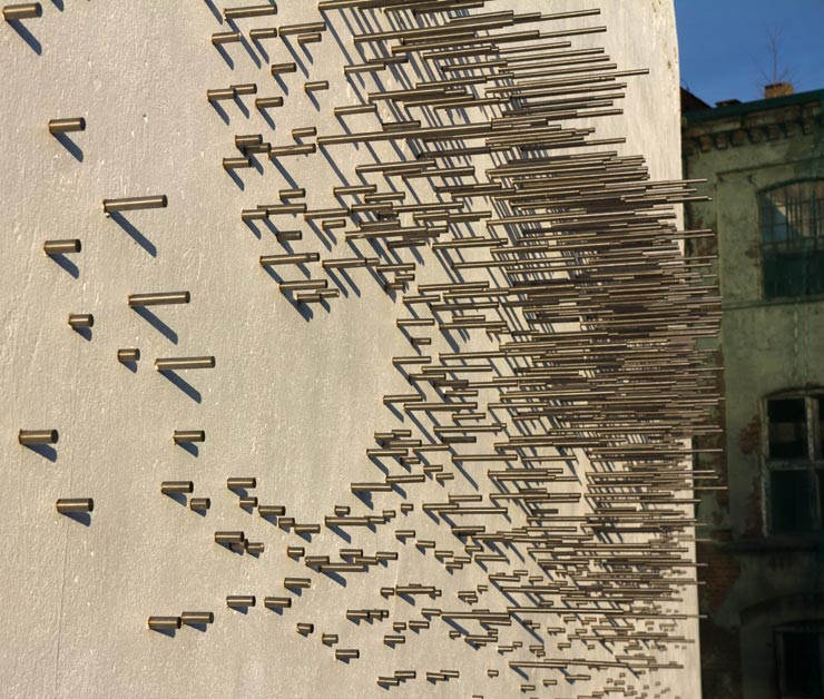 "1300 Metal Bars in Lodz: Cekas Creates Sculptural ""Silence"" on a Wall"
