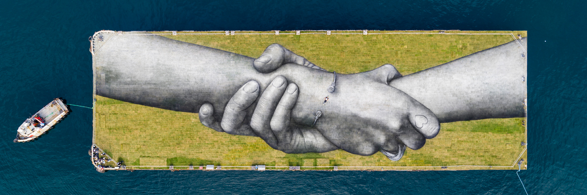 Saype Brings Symbol of Joined Hands to East/West Precipice in Istanbul