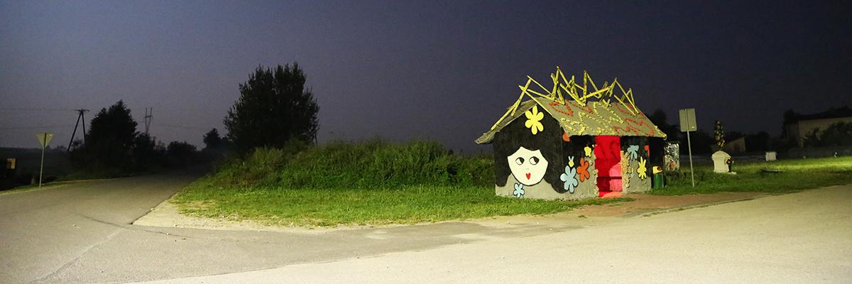 Roxi Rocks a Bus Stop in Święcica Poland, Inspired With Olek